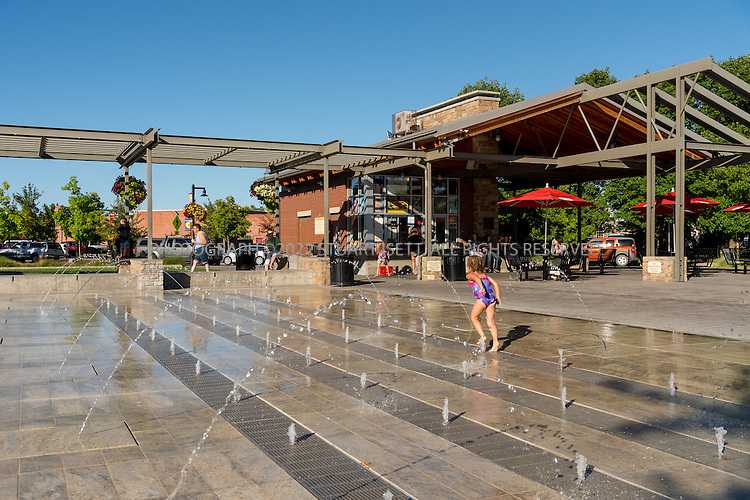 7/15/2016-- Redmond, Oregon, USA<br /> <br /> <br /> CENTENNIAL PARK<br /> REDMOND, OR<br /> Developed in conjunction with a renovation of City Hall, this park and plaza give the city a new focal point for civic life. With outdoor festivals, a weekly Farmer&rsquo;s Market, a splash play fountain and other creative public spaces, it offers a much-needed space for downtown recreation. <br /> <br /> Designed by Walker Macy.<br /> <br /> Walker Macy provides landscape architecture, urban design and planning firm services throughout the West. The firm utilizes creative solutions to transform public and private spaces for a variety of sectors, including urban plazas and parks; waterfront revitalization projects; higher education and healthcare; and mixed-use developments. Founded in 1976, Walker Macy serves its regional clients through two offices in Portland, OR and Seattle, WA.<br /> <br /> <br /> Photograph by Stuart Isett.
