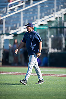 Tri-City Dust Devils pitching coach Giancarlo Alvarado (30) walks to the mound during a Northwest League game against the Everett AquaSox at Everett Memorial Stadium on September 3, 2018 in Everett, Washington. The Everett AquaSox defeated the Tri-City Dust Devils by a score of 8-3. (Zachary Lucy/Four Seam Images)
