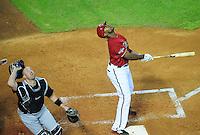 Jun. 1, 2011; Phoenix, AZ, USA; Florida Marlins catcher John Buck tracks the foul popup hit by Arizona Diamondbacks batter Justin Upton in the fifth inning at Chase Field. Mandatory Credit: Mark J. Rebilas-