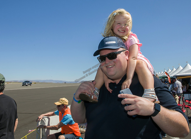 Three-year-old Emma with dad Matt Miller during the National Championship Air Races in  Reno, Nevada on Saturday, Sept. 14, 2019.