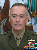 United States Marine Corps General Joseph F. Dunford Jr., Chairman, Joint Chiefs of Staff, looks on as US President Donald J. Trump makes remarks prior to signing H.R. 2810, National Defense Authorization Act for Fiscal Year 2018, in the Roosevelt Room of the White House in Washington, DC on Tuesday, December 12, 2017.<br /> Credit: Ron Sachs / CNP