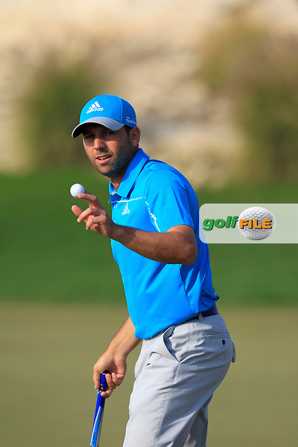 Sergio Garcia (ESP) sinks his birdie putt on the 16th green during Saturday's Final Round of the Commercial Bank Qatar Masters 2014 held at Doha Golf Club, Doha, Qatar. 25th January 2014.<br /> Picture: Eoin Clarke www.golffile.ie