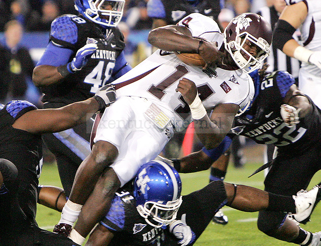 Mississippi State senior quarterback Chris Relf is sacked by University of Kentucky defenders during the first half of UK's blackout home game at Commonwealth Stadium.