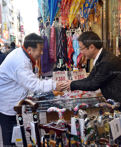 Decem ber 7, 2014, Tokyo, Japan - Yukio Edano, secretary-general of the Democratic Party of Japan, greets and shakes hands with Sunday shoppers in his campaign stop at the shopping street in Tokyo's 10th precint on Sunday afternoon, December 7, 2014. Latest polls showed the main opposition DPJ was far from becoming a major threat to the dominance of the ruling Liberal Democreatic Party in the December 14 parliament's lower house election. (Photo by Natsuki Sakai/AFLO) AYF -mis-