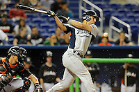 7 March 2012:  FIU utility player Oscar Aguirre (8) bats as the Miami Marlins defeated the FIU Golden Panthers, 5-1, at Marlins Park in Miami, Florida.