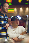 Eric Mizrachi talks to brother, Michael, during a hand.