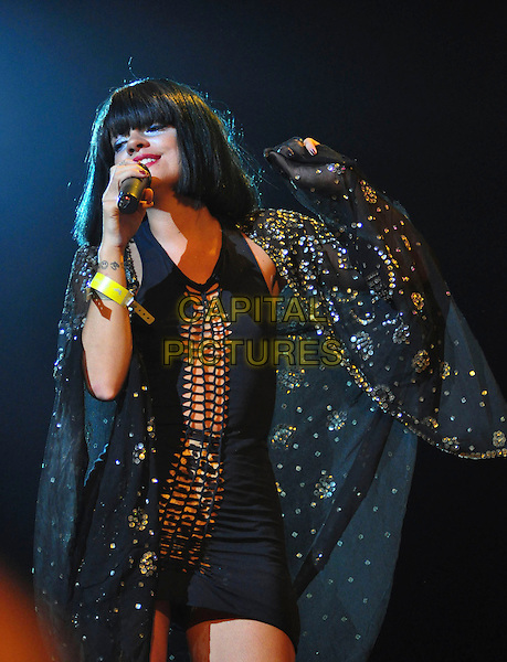 LILY ALLEN .Performs on day three of the Roskilde Festival in Roskilde, Denmark, .July 4th 2009..music live on stage gig concert half length wig sparkly cap black beaded sequined tattoo gold dress cut out leopard print knickers pants underwear microphone singing .CAP/TTL .©TTL/Capital Pictures