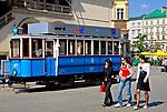 Zabytkowy tramwaj na Rynku Glownym w Krakowie<br /> An antique tram near Cloth Hall on the Main Market in Cracow, Poland