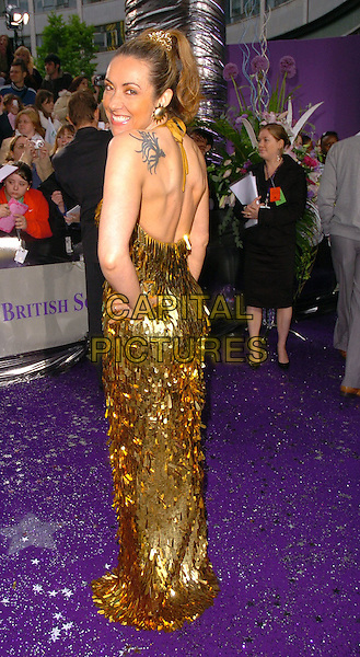 GMTV PRESENTER.The Brtish Soap Awards - Arrivals,.BBC Television centre, London, .May 20th 2006..full length gold dress sequined back behind tattoo on shoulder.Ref: CAN.www.capitalpictures.com.sales@capitalpictures.com.©Can Nguyen/Capital Pictures