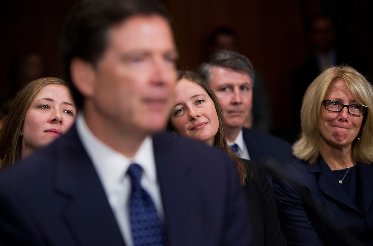 UNITED STATES - JULY 9: James Comey, nominee for FBI Director, testifies during his conformation hearing before the Senate Judiciary Committee in Dirksen Building as his daughters Kate, left, and Maureen and his wife Patrice, look on. (Photo By Tom Williams/CQ Roll Call)
