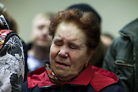 Moscow, Russia, 30/03/2010..A woman weeps as people lay flowers and light candles at a makeshift shrine on the spot inside Lubyanka metro station where a female suicide bomber blew herself up the previous day. At least 39 people were killed and 80 injured in the double blasts at Moscow metro stations during the morning rush hour.