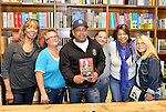 CORAL GABLES, FL - JANUARY 31: Daymond John (C) and his mother Margot John (L) greets fans and signs copies of his book 'The Power of Broke: How Empty Pockets, a Tight Budget, and a Hunger for Success Can Become Your Greatest Competitive Advantage at Books and Books on January 31, 2016 in Coral Gables, Florida.   ( Photo by Johnny Louis / jlnphotography.com )