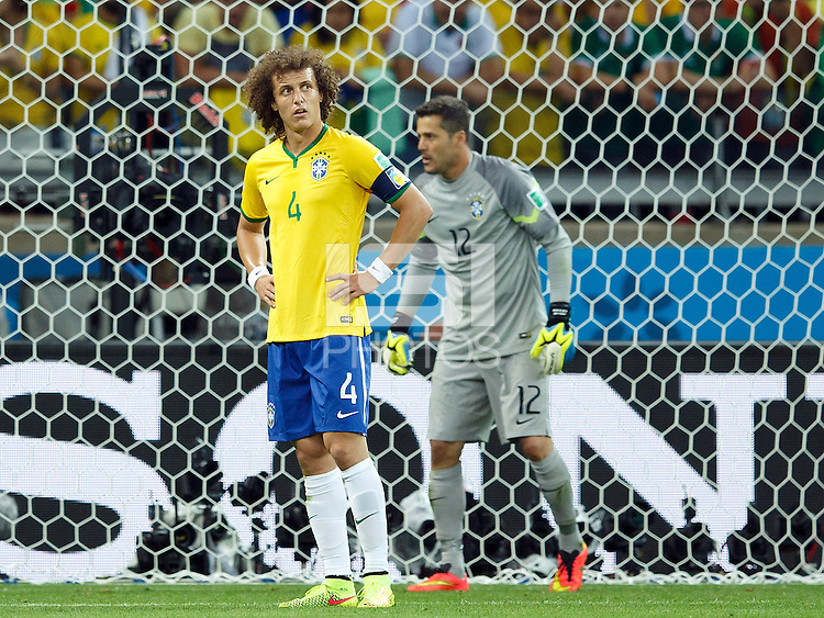 David Luiz of Brazil looks dejected with goalkeeper Julio Cesar