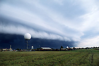 A WSR-88d doppler radar scans the skies over the National Severe Storms Laboratory in Norman Oklahoma as a tiered shelf cloud heralds the approach of a severe thunderstorm's gust front. Shelf cloud formations such as these often create wind shears that are extremely hazardous to aircraft