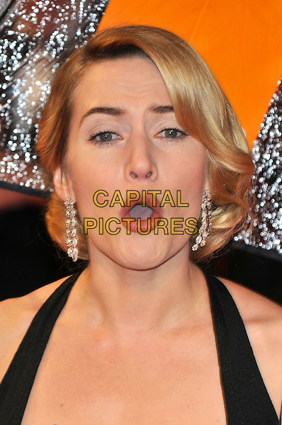 KATE WINSLET .The Orange British Academy Film Awards 2009, Royal Opera House, Covent Garden, London, England, February 8th 2009..BAFTAS arrivals portrait headshot black halterneck diamond dangly earrings hair up mouth open funny face .CAP/PL.©Phil Loftus/Capital Pictures