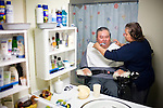 In Home Supportive Services (IHSS) caregiver Teresita Perez de Godoy, right, cleans the teeth of quadriplegic Francisco Godoy in his Sacramento, CA home January 22, 2010. Francisco needs around-the-clock care from Teresita, his ex-wife who also lives with him. The state pays Teresita for 283 hours per month, at $10.40/hour. Gov. Schwarzenegger has proposed cutting or eliminating the IHSS program which provides care for 450,000 Californians and jobs for 375,000 caregivers. If the program was eliminated, most would need to be institutionalized, likely at far greater taxpayer expense. CREDIT: Max Whittaker for The Wall Street Journal.CABUDGET