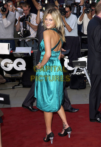 FEARNE COTTON .GQ  Men Of The Year Awards at the Royal Opera House, Covent Garden, London, WC2. September 6th, 2005 .full length looking over shoulder blue turquoise dress black diamante heels tattoo henna hand on hip silk satin green .www.capitalpictures.com sales@capitalpictures.com .© Steve Finn/Capital Pictures