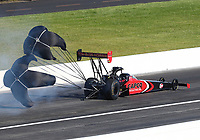 Jul 12, 2020; Clermont, Indiana, USA; NHRA top fuel driver Steve Torrence deploys his parachutes during the E3 Spark Plugs Nationals at Lucas Oil Raceway. This is the first race back for NHRA since the start of the COVID-19 global pandemic. Mandatory Credit: Mark J. Rebilas-USA TODAY Sports