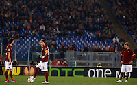 Calcio, Europa League: Ritorno degli ottavi di finale Roma vs Fiorentina. Roma, stadio Olimpico, 19 marzo 2015.<br /> From left, Roma's Miralem Pjanic, Adem Ljajic and Daniele De Rossi reacts after Fiorentina scored during the Europa League round of 16 second leg football match between Roma and Fiorentina at Rome's Olympic stadium, 19 March 2015.<br /> UPDATE IMAGES PRESS/Riccardo De Luca