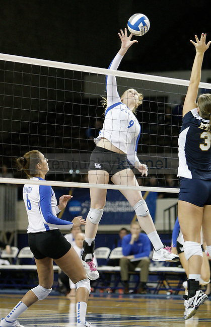 Freshman Sara Swarzwalder (9) spikes the ball during the UK women's volleyball game v. East Tennessee University during the NCAA tournament in Memorial Coliseum in Lexington, Ky., on Friday, November 30, 2012. Photo by Genevieve Adams | Staff