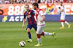 Rayo Vallecano´s insua (R) and Barcelona´s Andres Iniesta during La Liga match between Rayo Vallecano and Barcelona at Vallecas stadium in Madrid, Spain. October 04, 2014. (ALTERPHOTOS/Victor Blanco)