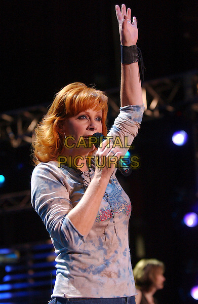 REBA McENTIRE.2007 CMA Music Festival held at LP Field, Nashville, Tennessee, USA..June 7th, 2007.half length stage concrt live gig performance music blue top singing arm in air bracelet.CAP/ADM/LF.©Laura Farr/AdMedia/Capital Pictures