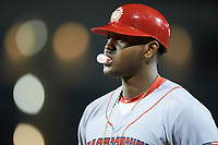 Jamori Blash (26) of the Hagerstown Suns coaches first base during the game against the Greensboro Grasshoppers at First National Bank Field on April 6, 2019 in Greensboro, North Carolina. The Suns defeated the Grasshoppers 6-5. (Brian Westerholt/Four Seam Images)