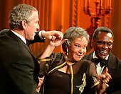 Washington, D.C. - February 6, 2006 -- United States President George W. Bush dances with an unidentified woman as Arthur Mitchell, Founder and Artistic Director, Dance Theatre of Harlem looks on following a performance in Washington, D.C. on February 6, 2006.  <br /> Credit: Ron Sachs / CNP