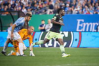 BRONX, NY - Sunday May 3, 2015: Obafemi Martins scores the first goal of the game.  Expansion team New York City FC takes on the Seattle Sounders at home at Yankee Stadium during the MLS regular season.