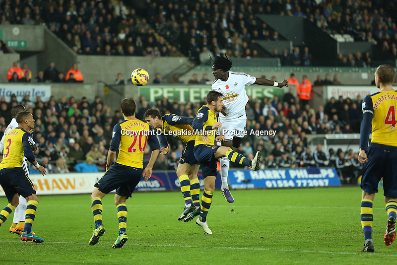 Sunday 09 November 2014 <br /> An ecstatic Bafetimbi Gomis of Swansea scores a goal with a header making the score 2-1 to his team<br /> Barclays Premier League, Swansea City FC v Arsenal City at the Liberty Stadium, Swansea, Great Britain. EPA/Dimitris Legakis
