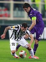 Calcio, ritorno degli ottavi di finale di Europa League: Fiorentina vs Juventus. Firenze, stadio Artemio Franchi, 20 marzo 2014. <br /> Juventus forward Carlos Tevez, of Argentina, left, and Fiorentina defender Gonzalo Rodriguez, of Argentina, fight for the ball during the Europa League round of 16 second leg football match between Fiorentina and Juventus at Florence's Artemio Franchi stadium, 20 March 2014. Juventus won 1-0 to advance to the round of eight.<br /> UPDATE IMAGES PRESS/Isabella Bonotto