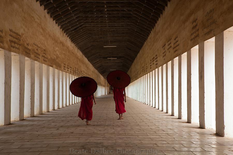 Two monks in the walkway of the Shwezigon pagoda, Bagan, Myanmar