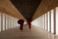 Two monks in the walkway of the Shwezigon pagoda, Bagan, Myanmar