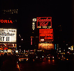Broadway and 42 street at night time.Series of images from New York between 1975 -1977. New York,USA.