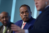 Washington, DC - April 8, 2014:  Fox News political analyst Juan Williams (c) moderates a panel discussion with Philadelphia Mayor Michael Nutter and Mayor Mitch Landrieu (r) of New Orleans. The panel was part of the Aspen Institute's 'Symposium on The State of Race in America' at the Newseum in the District of Columbia. (Photo by Don Baxter/Media Images International)