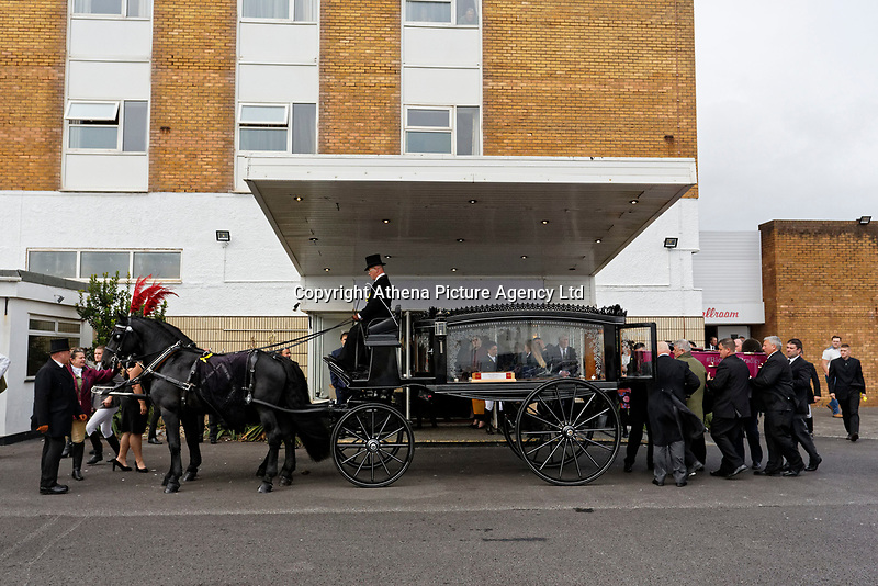 """Pictured: The coffin of Bradley John is being loaded to a horse drawn carriage at Aberavon Beach Hotel, Wales, UK. Monday 08 October 218<br /> Re: A grieving father will mourners on horseback at the funeral of his """"wonderful"""" son who killed himself after being bullied at school.<br /> Talented young horse rider Bradley John, 14, was found hanged in the school toilets by his younger sister Danielle.<br /> Their father, farmer Byron John, 53, asked the local riding community to wear their smart hunting gear at Bradley's funeral.<br /> Police are investigating Bradley's death at the 500-pupils St John Lloyd Roman Catholic school in Llanelli, South Wales.<br /> Bradley's family claim he had been bullied for two years after being diagnosed with Attention Deficit Hyperactivity Disorder.<br /> He went missing during lessons and was found in the toilet cubicle by his sister Danielle, 12."""