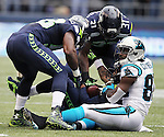 Seattle Seahawks free safety  Earl Thomas (26) is surrounded by strong safety Kam Chancellor (31) and linebacker Kevin Pierre-Louis (58) after he intercepted a pass from Carolina Panthers wide receiver Jerricho Cotchery (82)  at CenturyLink Field in Seattle on October 18, 2015. The Panthers came from behind with 32 seconds remaining in the 4th Quarter to beat the Seahawks 27-23.  ©2015 Jim Bryant Photography. All Rights Reserved.