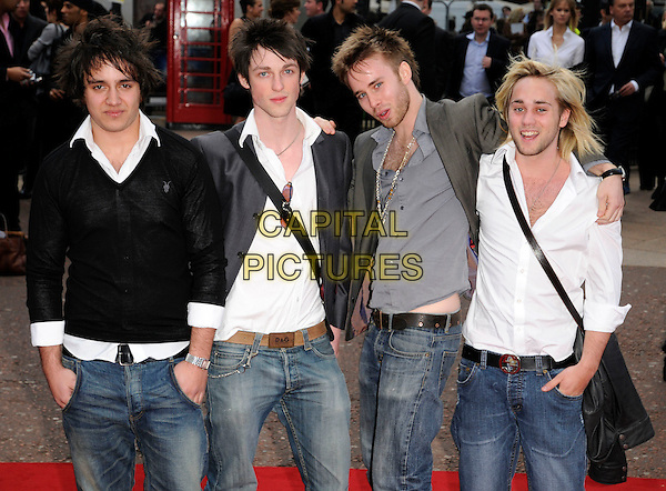"""THE STIFF DYLANS.UK Premiere of """"Iron Man"""" at the Odeon, Leicester Square, London, England..April 24th 2008.half length white shirt black grey gray top jeans denim.CAP/CAN.©Can Nguyen/Capital Pictures."""