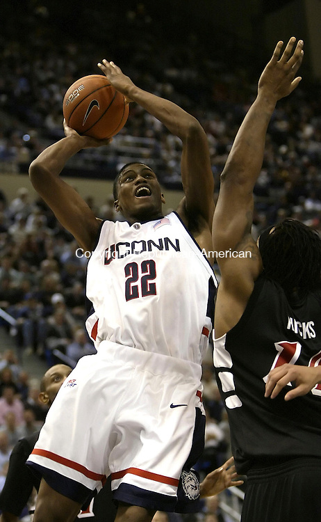 HARTFORD, CT 09 JANUARY 2005 010905BZ08-      UConn #22, Rudy Gay goes up against Cincinnati #14, Eric Hicks <br /> during their game at the Hartford Civic Center Monday night. <br /> Jamison C. Bazinet Republican-American