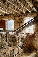 Hay shoot in a rustic barn.