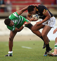 Manawatu winger Lote Raikabula tackles Robert Fruean during the Air NZ Cup preseason match between Manawatu Turbos and Wellington Lions at FMG Stadium, Palmerston North, New Zealand on Friday, 17 July 2009. Photo: Dave Lintott / lintottphoto.co.nz