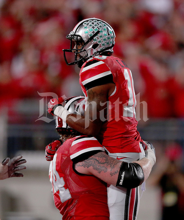 Ohio State Buckeyes wide receiver Philly Brown (10) celebrates a touchdown catch with teammate Ohio State Buckeyes offensive linesman Jack Mewhort (74) during the first half of the game between Ohio State and Wisconsin at Ohio Stadium on Saturday, September 28, 2013. (Columbus Dispatch photo by Jonathan Quilter)