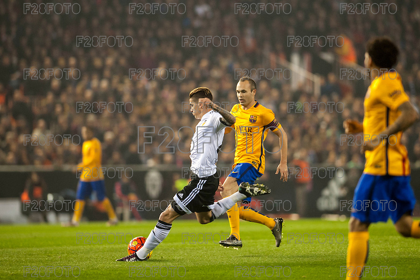 VALENCIA, SPAIN - DECEMBER 5: De Paul, Iniesta during BBVA LEAGUE match between Valencia C.F. and FC Barcelona at Mestalla Stadium on December 5, 2015 in Valencia, Spain