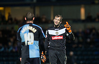 Goalkeeper Roy Carroll of Notts County speaks to goalscorer Michael Harriman of Wycombe Wanderers during the Sky Bet League 2 match between Wycombe Wanderers and Notts County at Adams Park, High Wycombe, England on 15 December 2015. Photo by Andy Rowland.