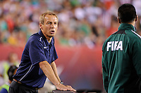 United States head coach Jurgen Klinsmann talks with the fourth official. The men's national teams of the United States (USA) and Mexico (MEX) played to a 1-1 tie during an international friendly at Lincoln Financial Field in Philadelphia, PA, on August 10, 2011.
