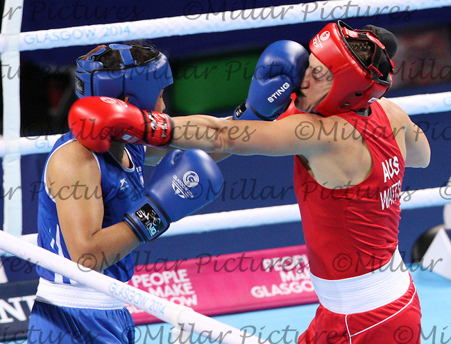 Shelley Watts of Team Australia in the red vest against Laishram Devi of Team India in the Women's Lightweight bout for the Gold Medal  in the Women's Flyweight bout for the Gold Medal  in the Boxing for the 20th Commonwealth Games, Glasgow 2014 at the SSE Hydro, Glasgow on 2.8.14.