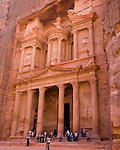 """The Treasury,"" Petra.  The first ""structure"" encountered after emerging from the Siq into the Nabatean ruins at Petra.  Carved completely by hand from the rock, this structure was probably actually a tomb.  It was dubbed ""the treasury"" due to a rumor that the Pharoah's gold was hidden in the carved ""urn"" shape at the top of this facade.  © Rick Collier"