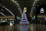 Christmas tree illuminated Terminal Five, Heathrow airport, London, England, UK