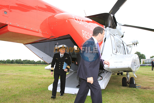 """Minister Dempsey signs New Search and Rescue Helicopter Contract on Behalf of the Irish Coast Guard..Picture Fran Caffrey/www.newsfile.ie..Minister Dempsey signs New Search and Rescue Helicopter Contract..""""These Helicopters will improve the capacity, range, speed and capability of Ireland's search and rescue service,"""" states Dempsey...New type Sikorsky S92A Helicopter on display at ceremony...The Minister for Transport Mr Noel Dempsey, T. D. today signed the contract awarding the provision of Helicopter SAR services to CHC Ireland. Transition to the modern helicopters will start in July 2012, and will run for ten years; with an option to extend for a further three years on a year by year basis. It represents a marked improvement in the capacity, range, speed and capability of Ireland's search and rescue service...The contract represents a continuation of the existing level of service with the principal change being the replacement of the Sikorsky S61N aircraft, with the 'new generation' Sikorsky S92A aircraft. These aircraft will operate out of Waterford, Shannon, Sligo and Dublin...Minister Dempsey said: """"I am delighted to sign this contract which will provide for the delivery of a top-class SAR service operating out of Bases in Waterford, Shannon, Sligo and Dublin up to 2022. There are over 130 jobs in this service and we anticipate that over 20 new posts will be created. CHC Ireland has an excellent record in delivering SAR services to our Coast Guard. The contract provides for helicopters that will fly to the scene of the mission faster. They find the vessels or persons in the water more efficiently using better search, surveillance and tracking tools. This will provide better medical facilities onboard and return people in danger to safety in the shortest possible time."""" ..Minister Dempsey added: """"I am also aware of the other supports that these helicopters can provide to the emergency services. These include Medevac for our Island and remote communities, mount"""