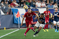 FOXBOROUGH, MA - AUGUST 31: Patrick Mullins #13 of Toronto FC and Michael Mancienne #28 of New England Revolution battle for the ball during a game between Toronto FC and New England Revolution at Gillette Stadium on August 31, 2019 in Foxborough, Massachusetts.